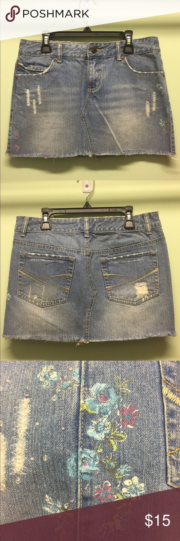 "Denim mini skirt NWOT. Denim mini skirt with decorative flower accent. Area designed to look ""ripped"" is re-enforced with stitching to prevent unraveling or damage. Aeropostale Skirts Mini"