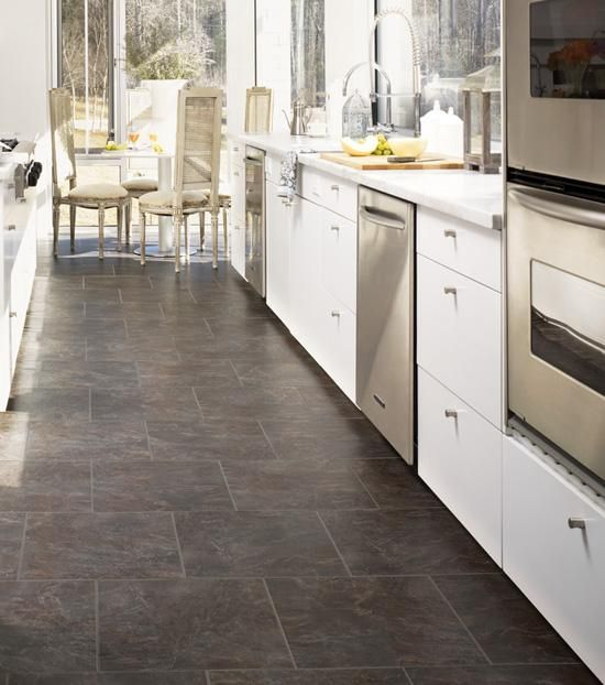 Gray porcelain tile with white cabinets.