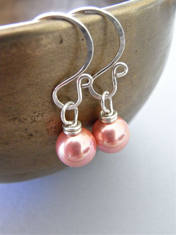 The Rosales earrings - petite, maintenance-free south sea shell pearls finished with my hand forged ear wires in sterling.  Sweet!