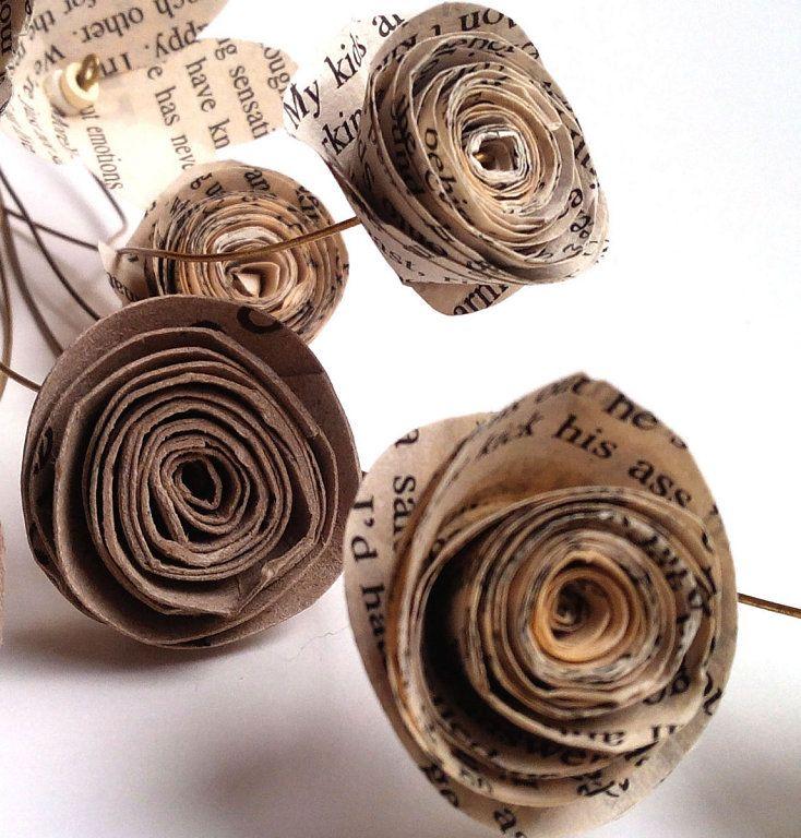 Flores reciclando papel periodico y rollos papel higienico