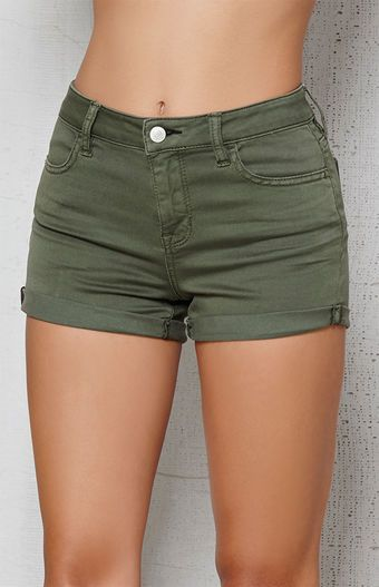 The Dusty Green Mid Rise Super Stretch Denim Shorts have timeless rolled hems and stretch fabric for the most comfortable wear. These denim shorts are finished with an olive green wash and comfy mid-rise fit. FIT + SIZING Mid rise 9'' rise 2.25'' inseam FABRICATION + CARE Olive green wash Button closure, zip fly Soft, stretch fabric Cuffed hems 75% cotton, 23% rayon, 2% spandex Machine washable MEASUREMENTS Model is wearing a size 25 Model's...