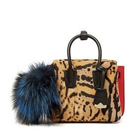 Classic meets counterculture on this eye-popping Rabbit charm. It combines Visetos printed coated canvas with lambskin trims and a pouf of voluminous fox fur, dyed in high-voltage colors. Use it to punch up your personal style — on the handle of a tote or wrangling a set of keys.