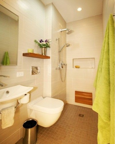 space saving door-less shower and wall-mounted toilet