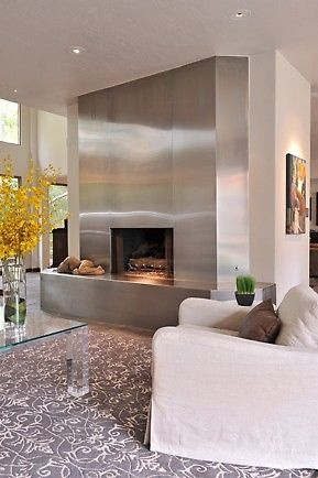 Stunning silver fireplace design in a contemporary home. via porch.com Dad can make this!