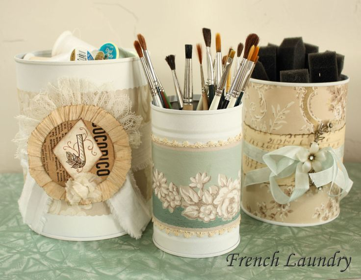 Spray paint used cans with white paint, then pretty them up with paper and ribbon for useful storage containers.