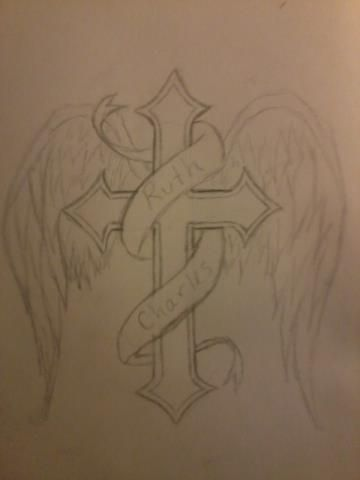 liking the cross...was looking for the perfect cross to tattoo with my brothers name...not sure about the wings though