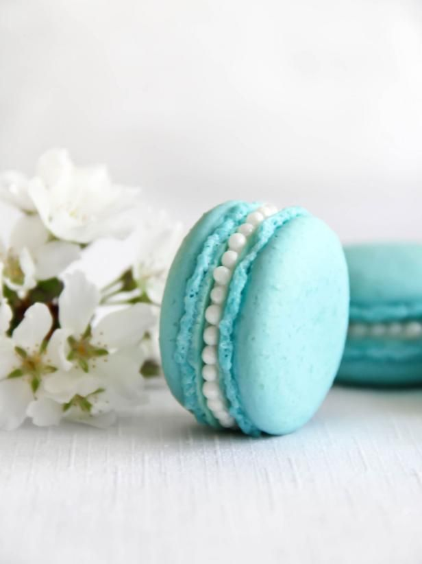 The finished product after adding a line of pearl dragees to the exposed orange blossom buttercream of these Tiffany Blue macarons.