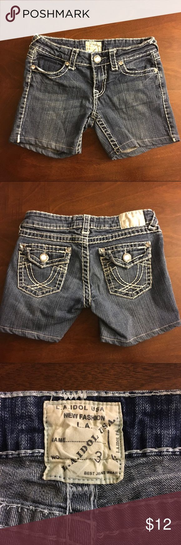 Denim shorts,white stitching bling buttons Great used condition denim shorts. White stitching and bling buttons. Size 3 L.A. idol USA Shorts Jean Shorts