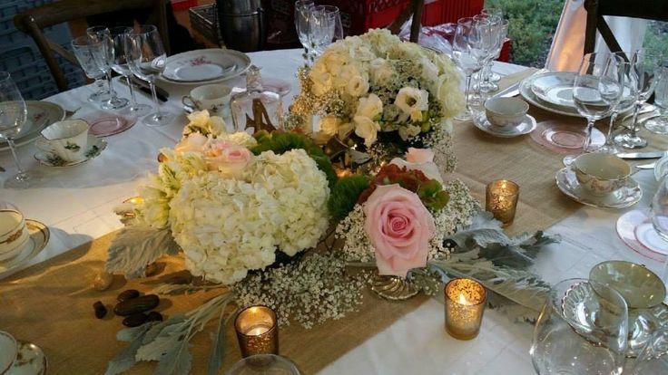 Artquest, Ltd low floral table design at Edgewood Valley Country Club in La Grange.   Check us out on Facebook and Instagram at artquestltd for more!