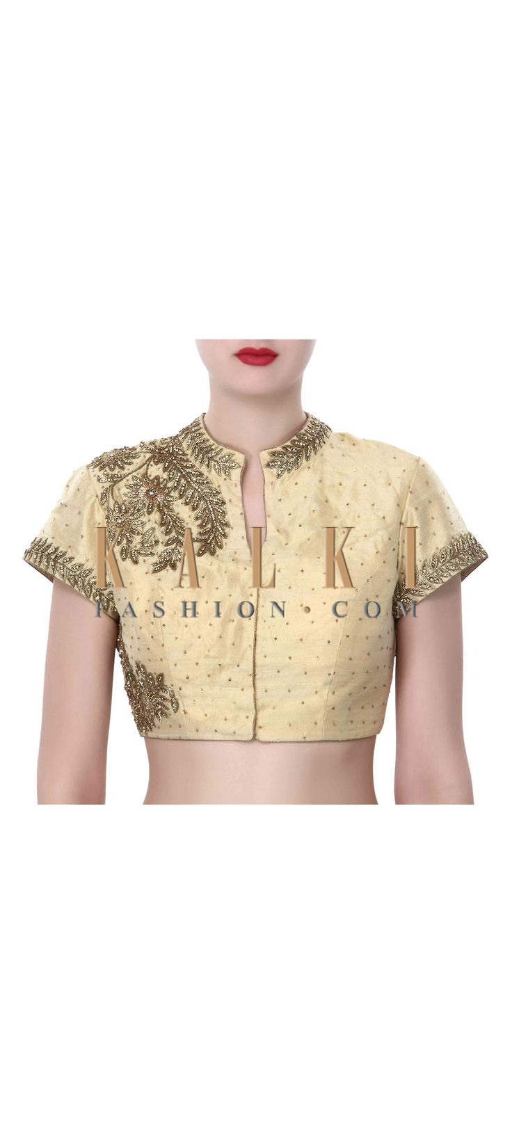 Buy Online from the link below. We ship worldwide (Free Shipping over US$100). Product SKU - 320013. Product Price - $159.00. Product Link - http://www.kalkifashion.com/beige-blouse-adorn-in-zardosi-embroidery-only-on-kalki.html