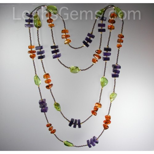 """This is a one of a kind necklace made with amethyst, young green amber and baltic amber. This colors together are really wonderful and fun. The lenght is60"""" long and is meant to be worn 2 or 3 times around your neck. There is no clasp.    Remember...I will only be making one of these!! $185.00"""