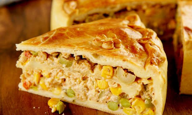"""What is it: A baked casserole usually made with chicken, olives, hearts of palm, corn, and other fillings. You can sub chicken for beef, shrimp, or any other type of """"meat.""""Tastes like: A chicken pot pie without the creaminess.Conclusion: Yo, chicken pot pie, take notes.Get a recipe here."""