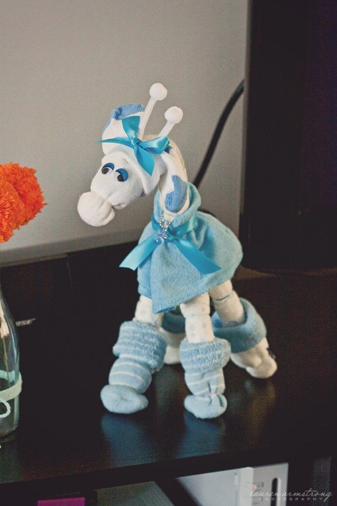 Giraffe: made from baby diapers, socks, and wash cloths.  http://projectnursery.com/projects/aqua-orange-baby-sprinkle/