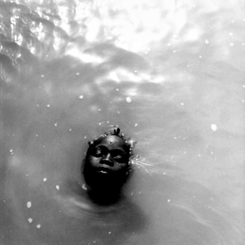 """""""Afloat."""" Something so haunting about this image."""