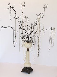 jewelry hanger made of wire vines in vintage lamp base also works well as a display stand for Christmas or seasonal ornament collection