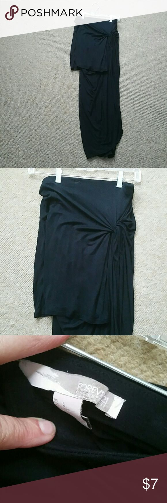 Half short half long black skirt Stretchy waist, fun skirt to wear out or as a beach cover up, hardly worn, runs a little small Forever 21 Skirts High Low