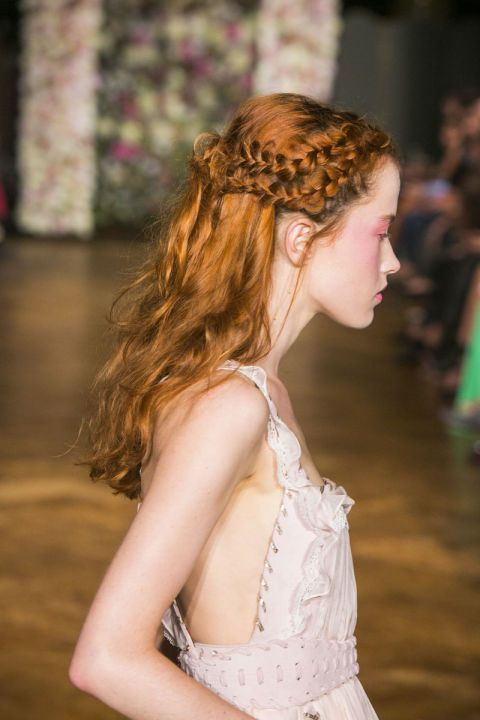 Antonio Corral Calero, Global Moroccanoil Ambassador, created these enchanting multi-braided hairstyles. The two braids at either side of the models head overlapped at the back and were secured by knotting the hair four times, with the ends left loosely hanging.