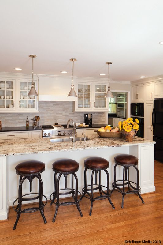 Mandi T Smith Interiors - Overstock barstools customized with a leather seat.