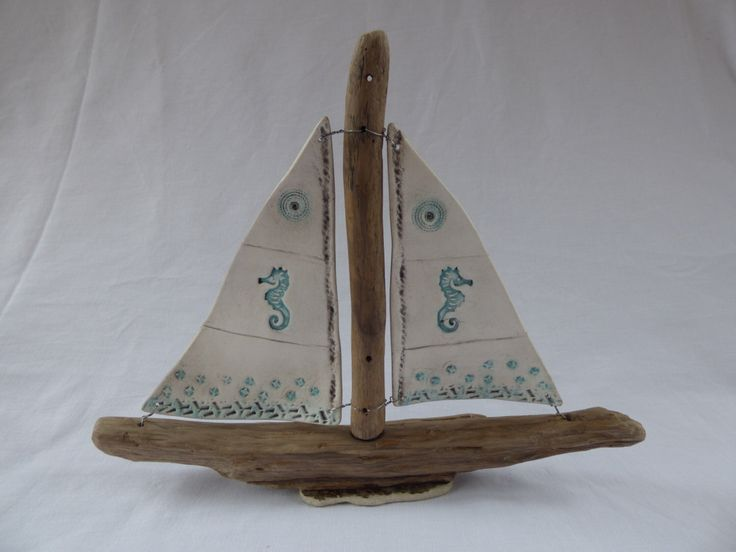 Clay sail driftwood boat by SharwoodDecor on Etsy https://www.etsy.com/uk/listing/469847941/clay-sail-driftwood-boat