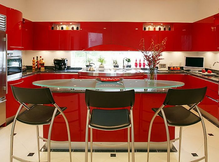 Bright Red Kitchen With White Floors And Black Accent Stools And Counters,  Raised Glass Top