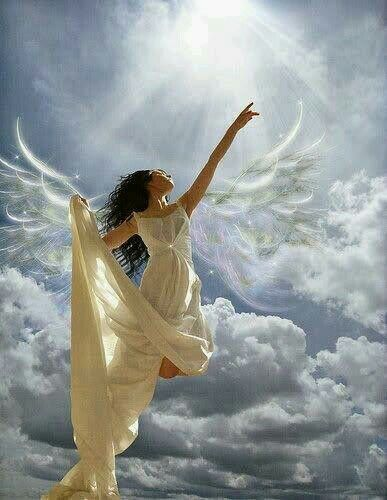 A beautiful angel in white pointing up to heaven.