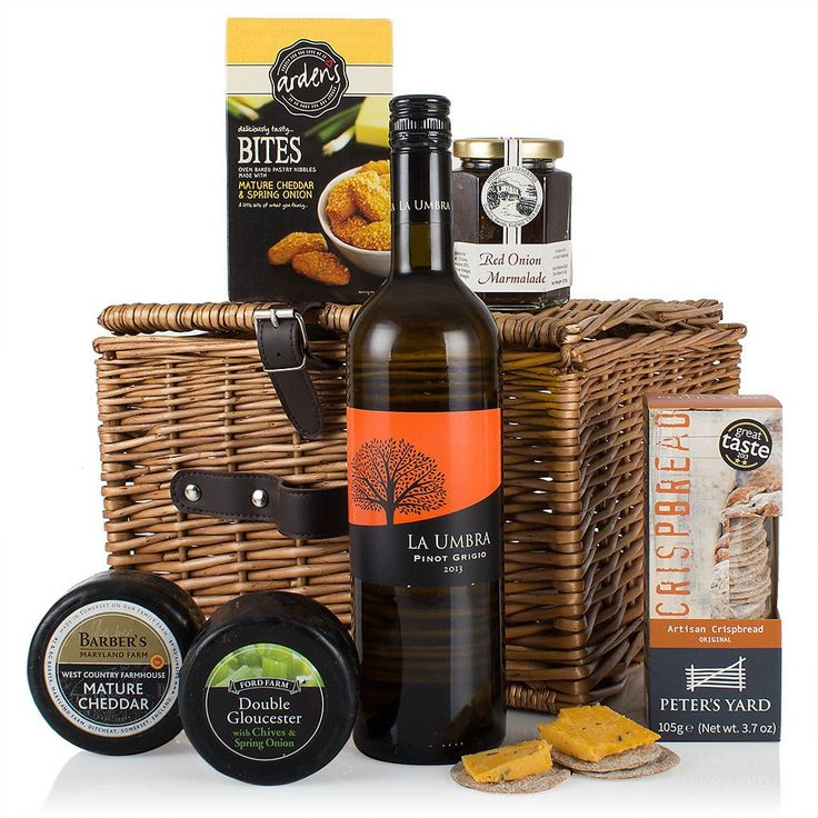 The Cheese and Wine Hamper | This traditionally styled picnic hamper is brimming with savoury delights such as Barbers Mature Cheddar, Double Gloucester with Chives and Spring Onions, perfectly partnered with Highfield Preserves Red Onion Marmalade and Peter's Yard Artisan Crispbread.  Should you feel a little parched after your cheese feast we have chosen a refreshing La Umbra Pinot Grigio to wash it all down