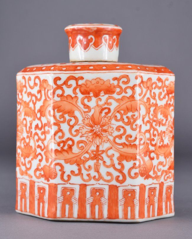 Chinese Qing Period Coral red enameled porcelain tea caddy; featuring lotus scroll design with lid; H: 15 cm, L: 12.5 cm