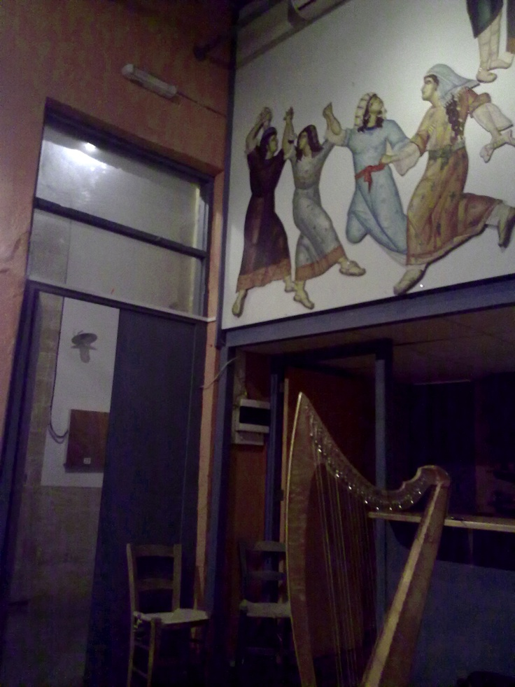 """Cypriot coffee-shop, Byzantine art, Irish harp. """"Kala Kathoumena"""", cafe and music venue, in the heart of the Old Town of Nicosia. Λευκωσία."""