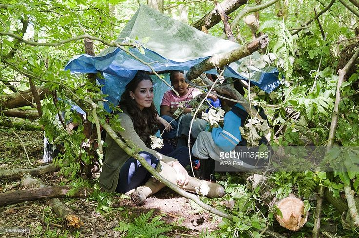 Catherine, Duchess of Cambridge interacts with schoolchildren at an 'Expanding Horizons' Primary School camp, taking part in various outdoor activities at the Widehorizons Margaret McMillan House in Kent, on June 17, 2012 in Wrotham, England.