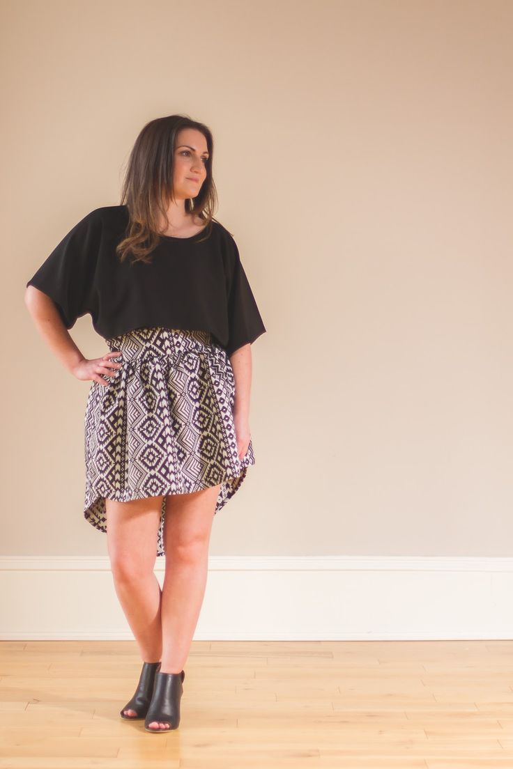 Black and white patterned skater skirt with high low hem worn with an oversized crop top