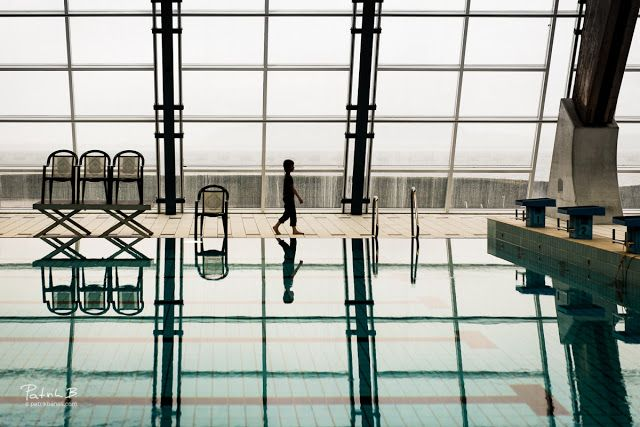 "curves and lines (and a boy!)  Being a passionate supporter of your daughter's synchro swimming hobby means sometimes spending whole days at a distance places and just ""kill the time"". Thankfully some of those places are pretty nice architectural pieces and so ""killing"" is actually quite fun. While swimmers were preparing for a final ""grand defilé"" I walked around a pool and pointed to a various angles looked for sexy curves and lines of the pool roof structure. And for one specific shot I…"