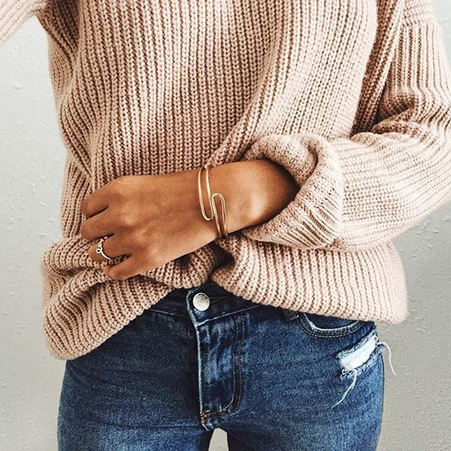 Sweater, jeans, and the prettiest gold accessories.                                                                                                                                                                                 More
