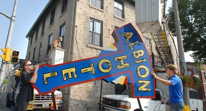 The Albion Hotel's refurbished neon sign is moved into place in this 2007 file photo. This year the Albion turns 155.