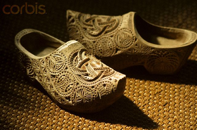 Dutch Antique Wooden Shoes with wedding carving in a Zaanlandse Oudheidkamer, a…