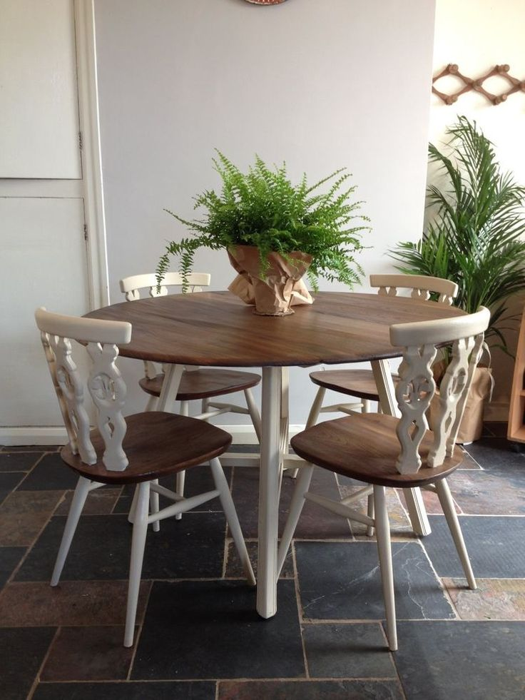 ercol drop leaf round table and four chairs