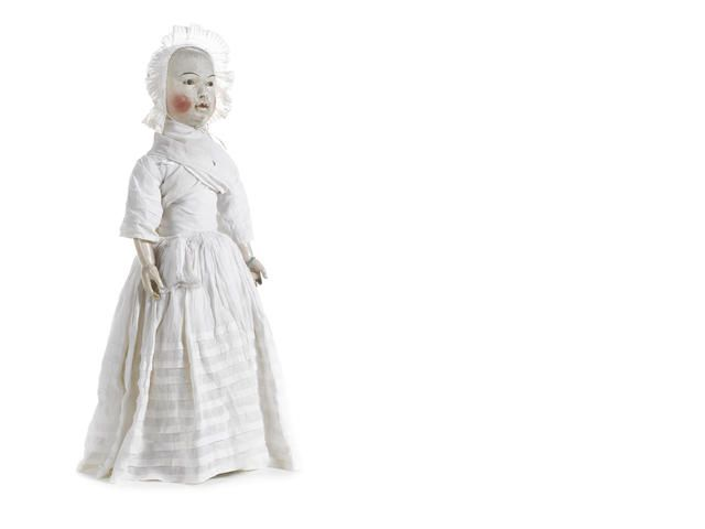 A rare and large William and Mary wooden doll, circa 1690