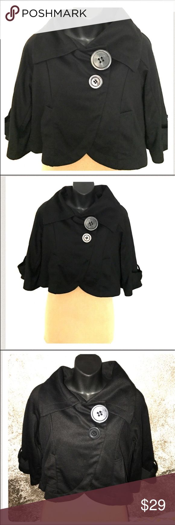 """Bell 3/4 sleeves crop vintage style shrug jacket M This crop vintage style jacket has large collar, snap buttons (adorned w/ large top button and smaller second button). Black. Bell sleeves come to my elbows. Cropped. Soft material. 80% polyester, 20% rayon. Two front pockets. Measures approximately 36.5"""" Width from under the armpit seam and around without stretching. Around 16.5 """"length. Sleeves approximately 17.5"""" from shoulder to end. Sleeves about 9.5"""" from armpit hem to end of sleeve…"""