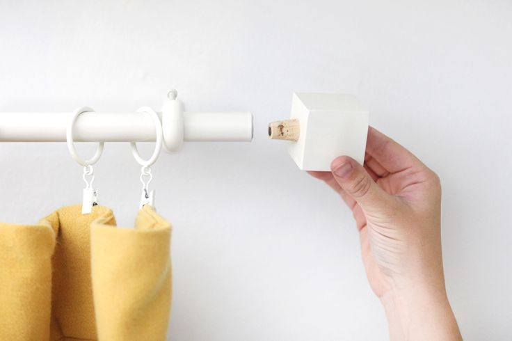 Save your dollars for drapes with this budget curtain rod & finial DIY!