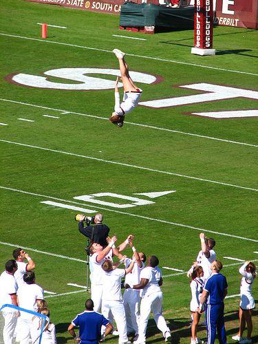 Ole Miss #Cheer, college cheerleading, in the air, stunt, cheerleader, collegiate - Head over Heels by Roger Smith, via Flickr Mississippi State cheerleading, cheerleaders