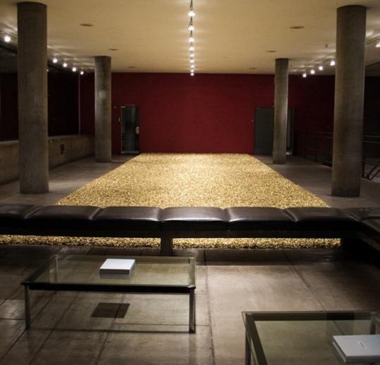 "Artwork by Felix Gonzalez-Torres - ""Untitled"" (Placebo – Landscape – For Roni), (1993) | gold cellophane–wrapped sweets, endless supply | Artstack - art online"