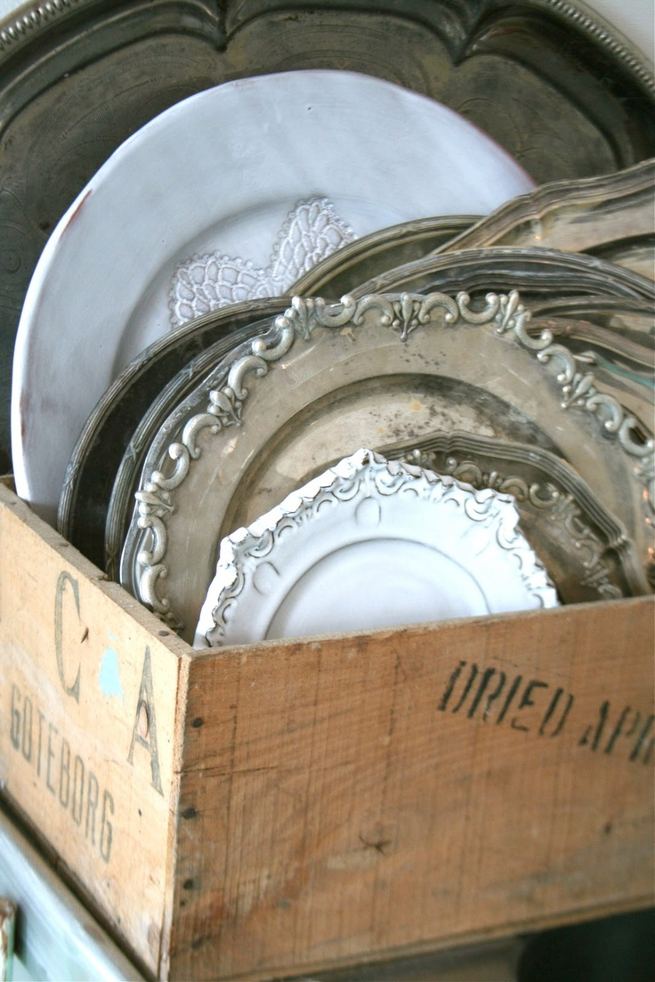 silver and ironstone platters in rustic box