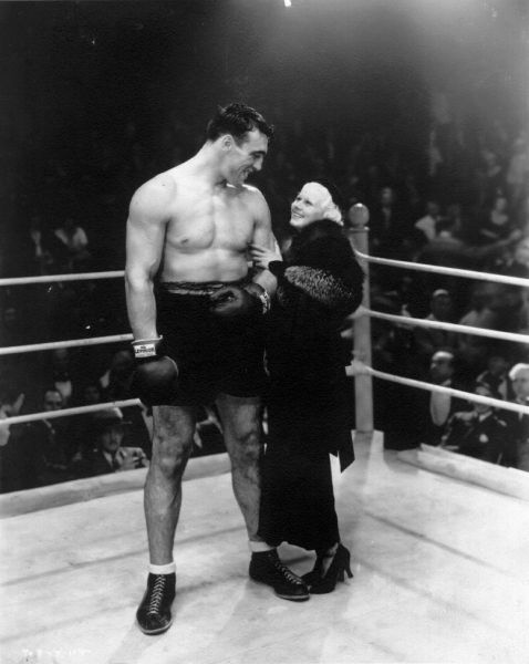 Jean Harlow with champion boxerMax Baer during the time they were dating c. 1933.