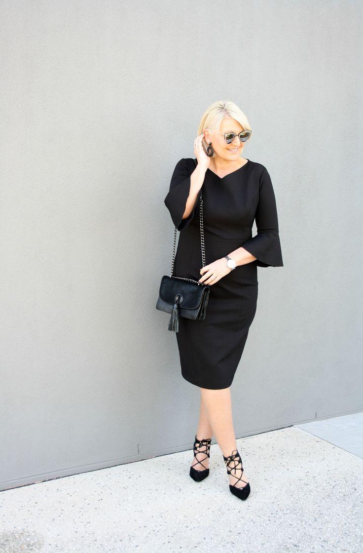 The gorgeous @irismaystyle wearing the Black Flared Sleeve Dress #acstyle