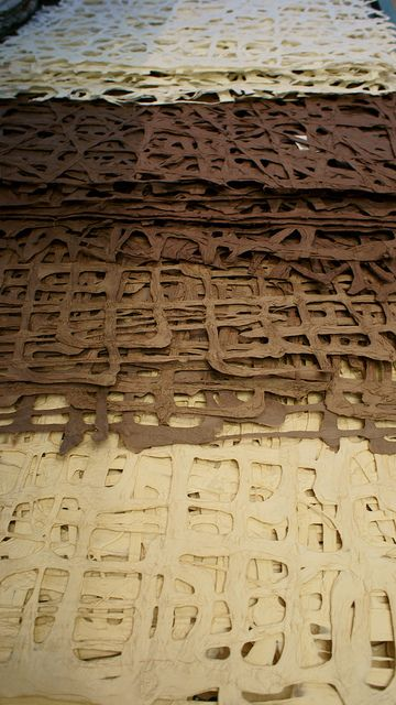Layers of hand made paper in earth colours by Otomodachi