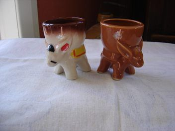brown and white/painted donkeys