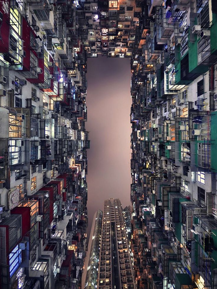 Hong Kong's architectural race to the sky is captured in a vertiginous view of its towering skyscrapers. Photographer:Romain Jacquet-Lagreze.