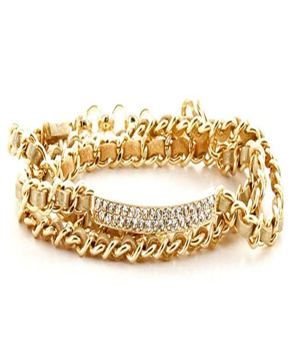LISA GOLD WOVEN CHAIN LINK BRACELET  Make your wrists glow! The Lisa bracelet features a wrap-around design, crystal encrusted I.D. plate and a weave through a gold-plated chain link. A look that will never lose its lustre.