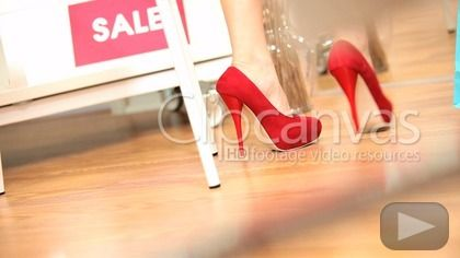 Girls in modern boutique trying fashionable shoes legs only HD Stock Footage Clip. Medium shot. 2012-08-15.
