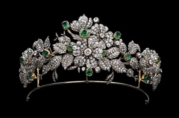 The spray of diamond and emerald roses, which rises above the frame, can be divided to wear as separate brooches or hairpins. Although not signed, it is in a Mellerio box. First half of the 19th century. Part of the Leuchtenberg inheritance