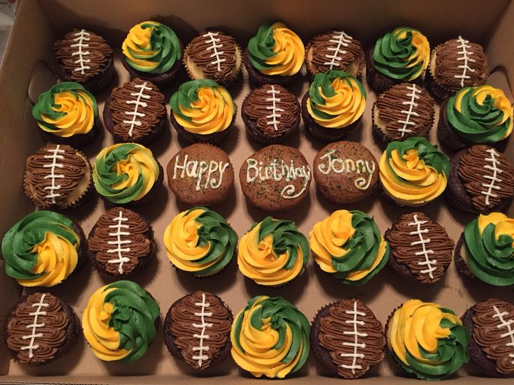 Green Bay Packers cupcakes for a birthday. Chocolate and vanilla cupcakes with chocolate (the footballs) and vanilla buttercream frosting.